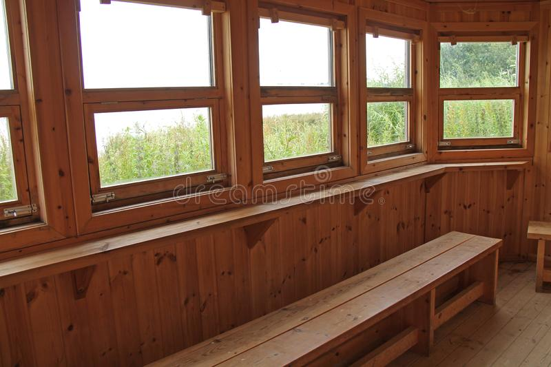 Bird Hide. The Inside of a Wooden Lakeside Bird Watching Hide royalty free stock photo
