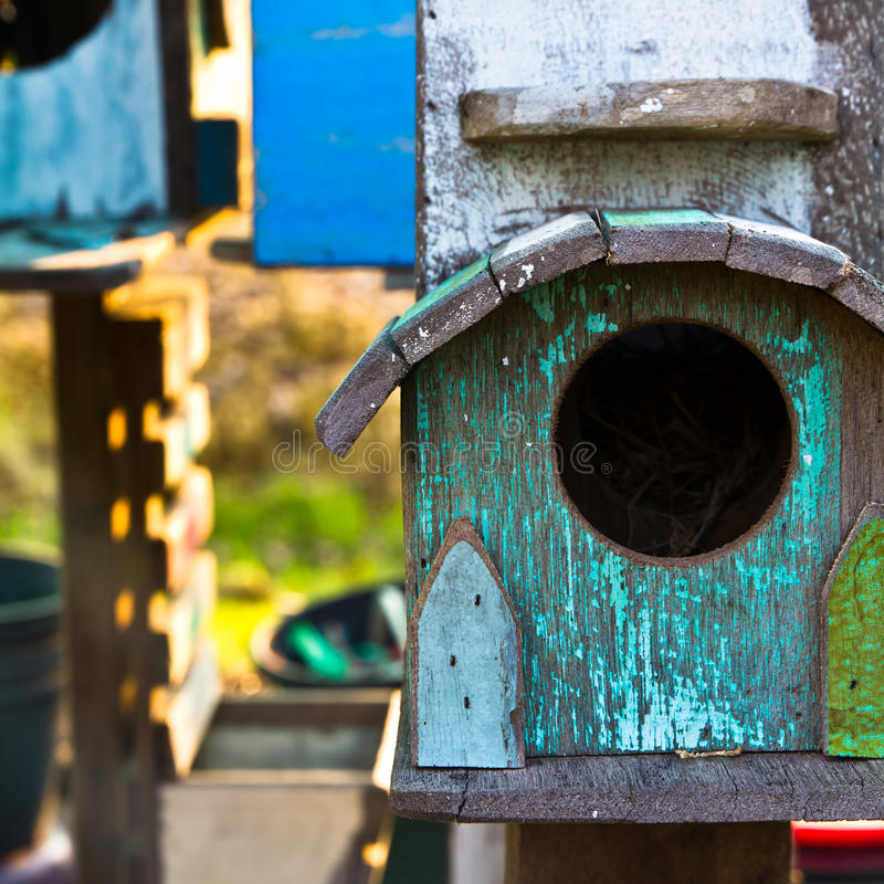 Bird house. Old wooden bird house in the garden royalty free stock images