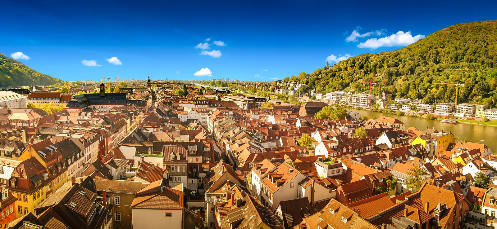 Bird panoramic view over old downtown in Heidelberg at sunny day and blue sky, Heidelberg, Germany, summer. Bird panoramic view over old downtown in Heidelberg stock photo