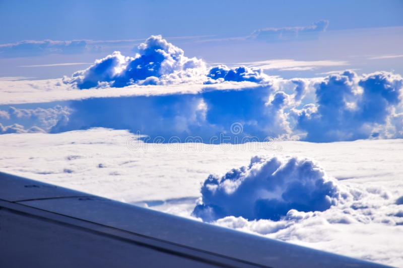 Bird`s eye majestic view of sky and clouds. Bird`s eye majestic view of sky and fluffy clouds from airplane window royalty free stock photos