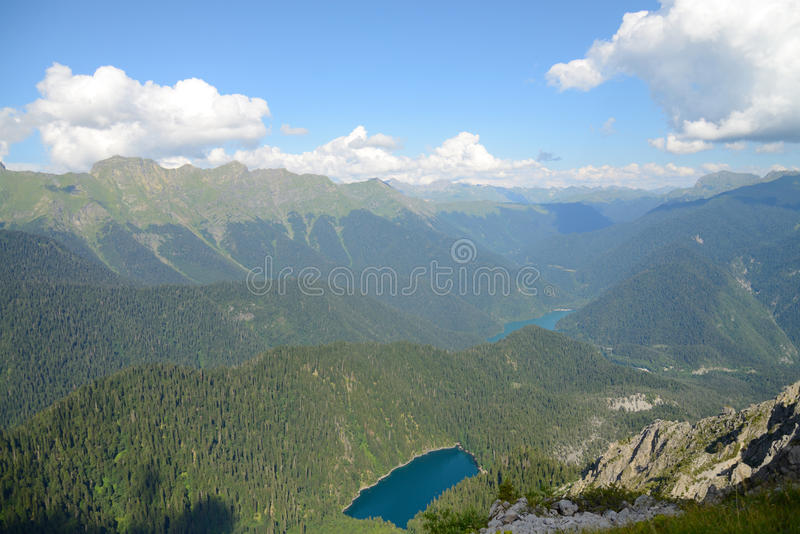 Bird`s eye view. A view from the air on two blue lakes, which is located among the pine forest, in a bowl of mountain ranges, Malaya Ritsa, Abkhazia stock photos