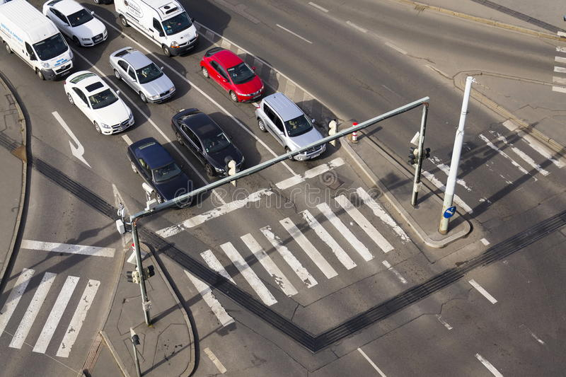 Bird`s eye view of cars waiting before crosswalk intersection on March 3, 2017 in Prague, Czech republic royalty free stock photo