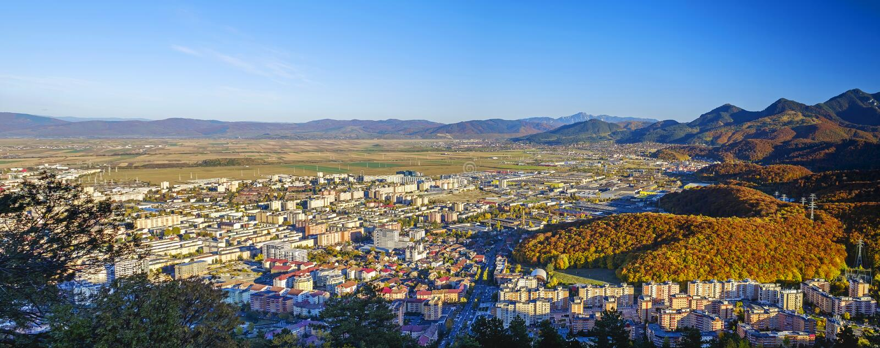 Bird`s eye view of city and mountains. Brasov, Romania 3. Bird`s eye view of city and mountains landscape. Brasov, Romania 3 stock photography