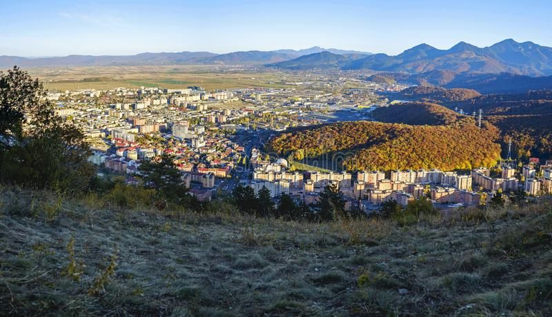 Bird`s eye view of city and mountains panorama. Brasov, Romania 2. Bird`s eye view of city and mountains panorama in Brasov, Romania 2 royalty free stock image