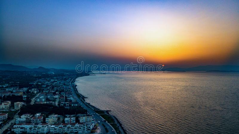Bird's Eye View of City Near Ocean During Dawn stock photos