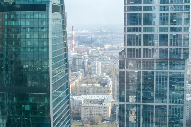 Bird`s-eye view of the city between two modern glass skyscrapers stock photos