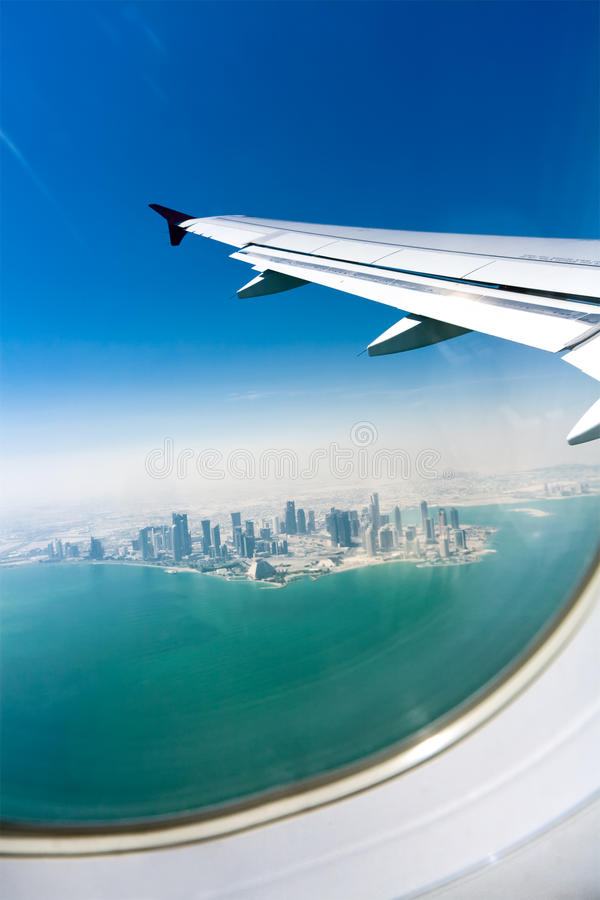 Bird's eye view on the city under the plane wing royalty free stock photos