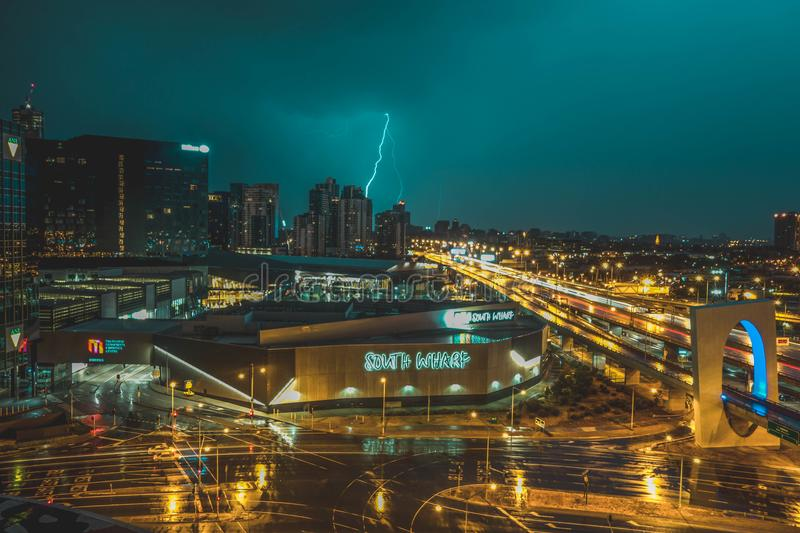 Bird's Eye View of Grey Building Near Road and Thunder Lighting Strike in Background stock photos