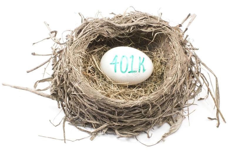 Bird's Nest with 401K Egg. A bird's nest with a 401K egg in it showing the concept of a retirement nest egg royalty free stock photos