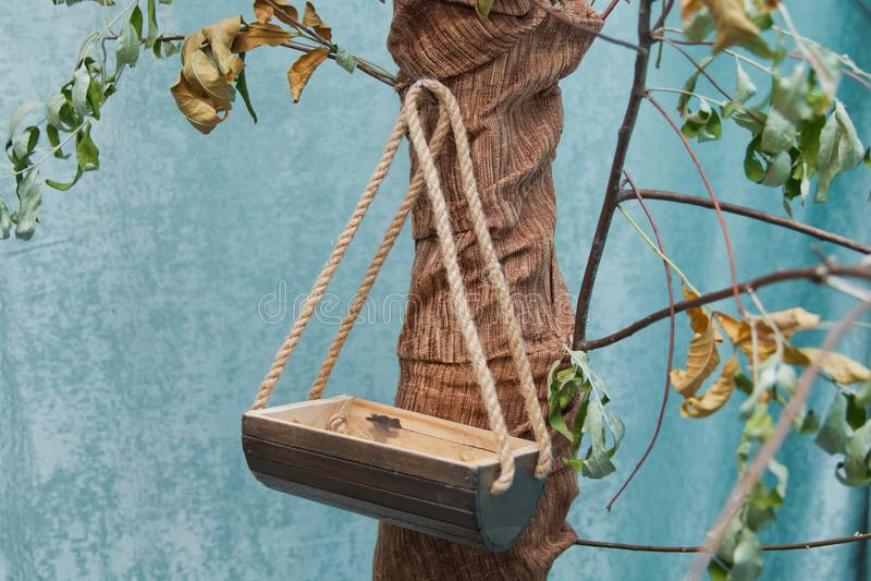 Bird`s nest on the tree. Old wooden birdhouse tied stock image
