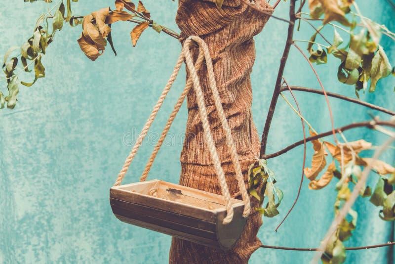Bird`s nest on the tree. Old wooden birdhouse tied stock photo
