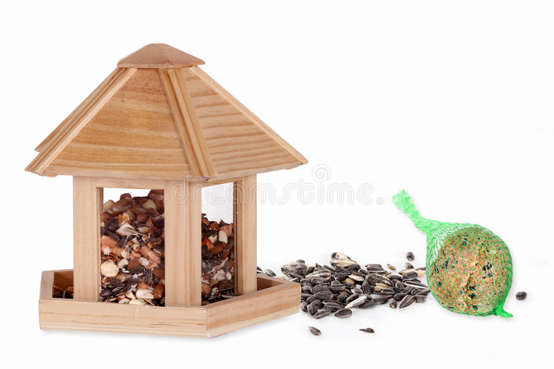Bird seed in a bird box with a fat ball stock photo