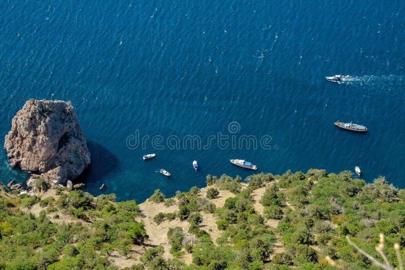 Bird view of Black Sea shore in Crimea near Sevastopol` city. People go sailing on yachts and boats near West coast of Crimea stock photos