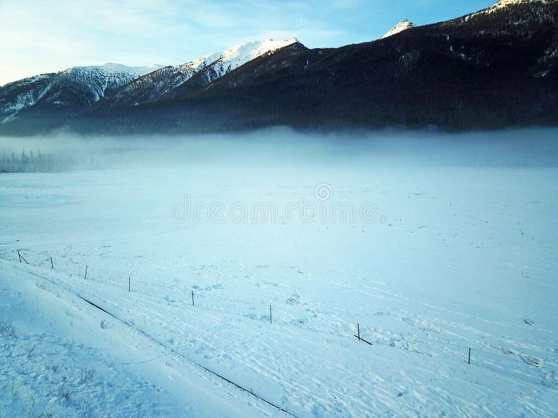 Bird view Kanas River in Xinjiang, China. Heavy snow-covered wooden houses in Hemu village in winter. Located within the Kanas Lake scenic area in the north of stock photography