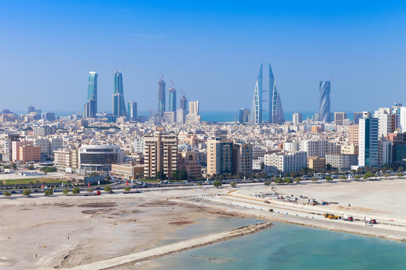Bird view of Manama, Bahrain. Skyline with skyscrapers. Bird view of Manama city, Bahrain. Skyline with modern skyscrapers standing on the coast of Persian Gulf stock photo