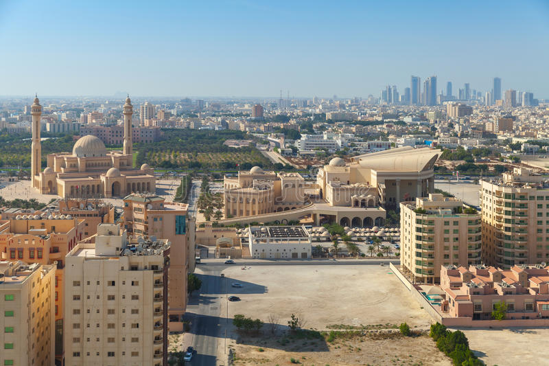 Bird view of Manama, the capital city of Bahrain. Bird view of Manama city, Bahrain. Skyline with old and modern buildings on the horizon royalty free stock image