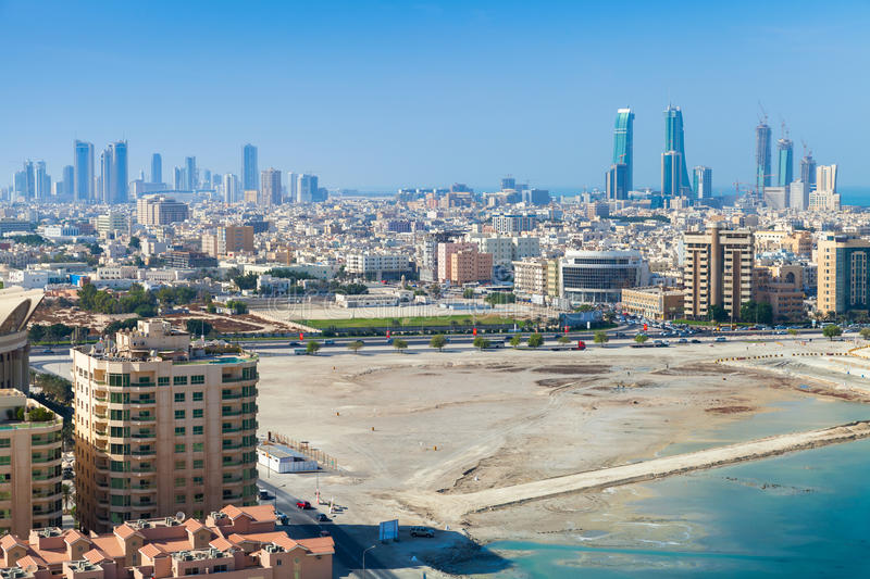 Bird view of Manama city, Bahrain, Middle East. Bird view of Manama city, Bahrain. Skyline with modern skyscrapers standing on coast of Persian Gulf royalty free stock images