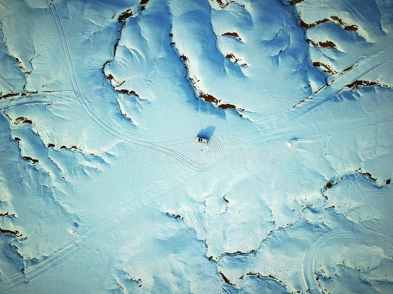 Bird View of Urho Ghost City in Winter. Snow-covered Urho Ghost City at sunset time in winter. Yardang landforms in Xinjiang,China. Located 100 km northeast stock photos
