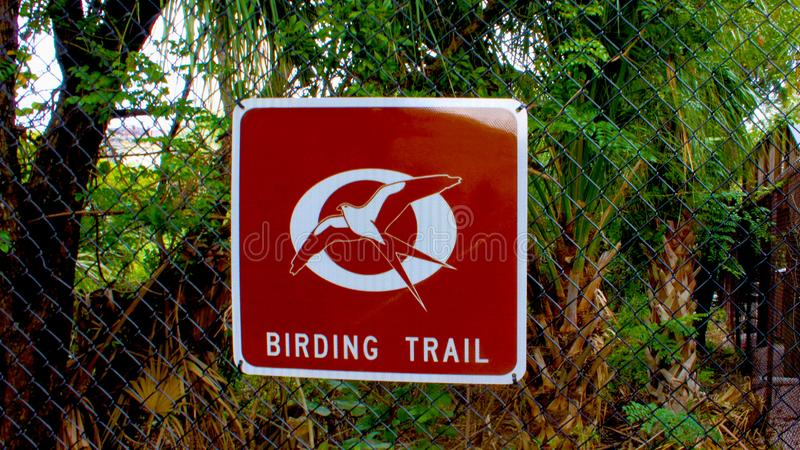 Bird watching trail brown and white metal sign royalty free stock photo
