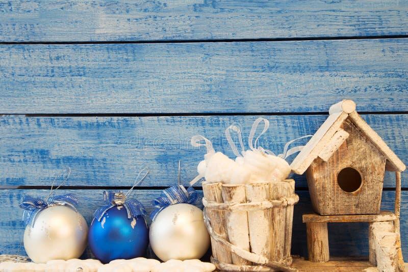 Birdhouse and Christmas decoration stock image
