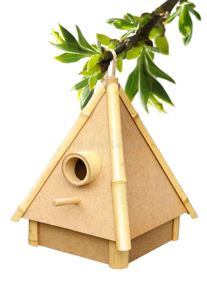 Birdhouse on sprig. Handmade birdhouse made from a bamboo on sprig royalty free stock photos