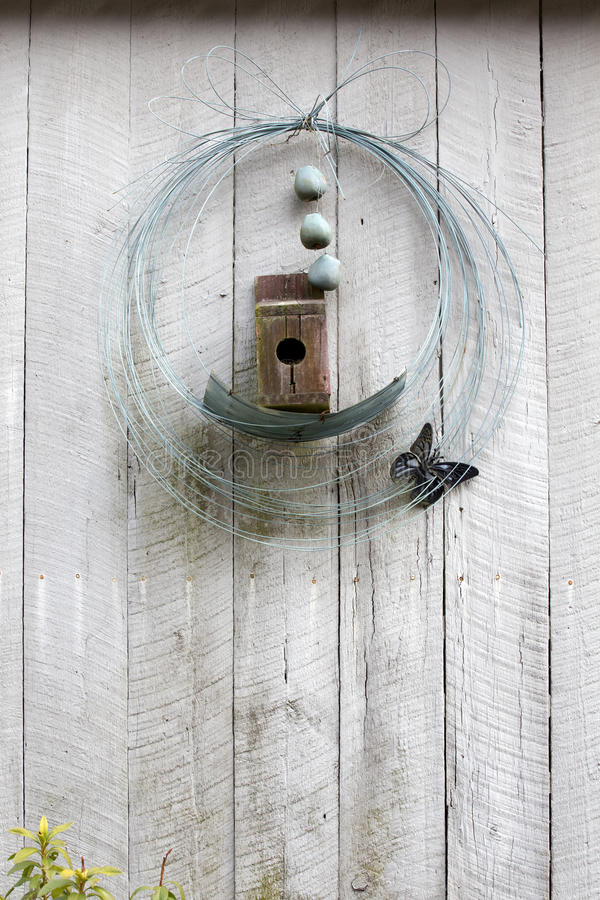 Birdhouse And Wire Wreath On Wall Stock Image - Image of container ...