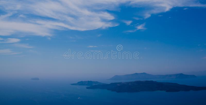 Birds Boats and Blue Greek Islands. A background scene taken from Oia on the Island of Santorini, Greece with shades of blue and boats and birds royalty free stock photography