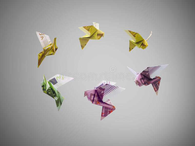 Birds of euro money fly out. Origami birds of euro money fly out stock photography