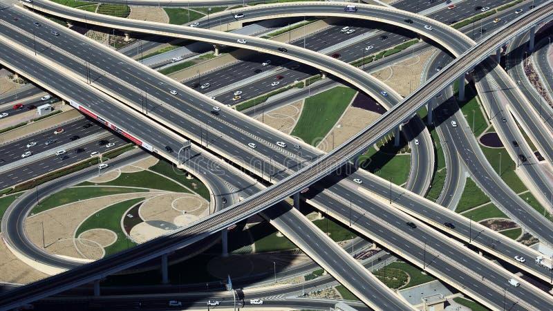 Traffic in Dubai, United Arab emirates, UAE. Birds eye view at highway traffic in Dubai as seen from tallest building in the world - Burj Khalifa, United Arab stock photos