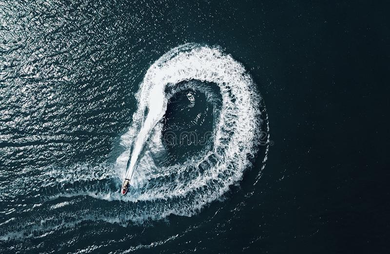 Jetski circles. Birds eye view of a jet ski going in an abstract circular pattern taken from a drone