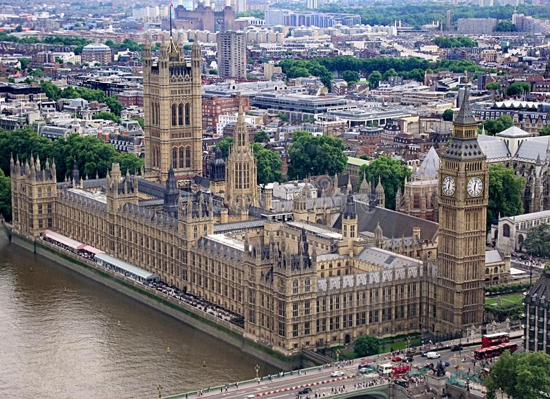 Birds eye view overlooking part of london with the houses of parliament in the forground. A vast potion of London as seen from the top of the stock photo
