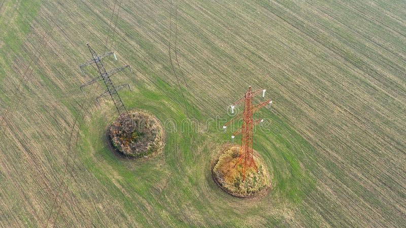 Birds eye view power line tower in autumn field. royalty free stock photos