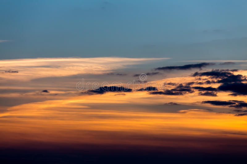 Birds flying in sunset. Against the evening sky royalty free stock photos