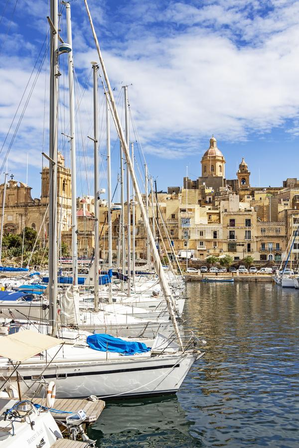 BIRGU, MALTA - MARCH 9, 2018: Birgu waterfront marina in front of Our Lady of Annunciation Church, St. Dominic`s Church. BIRGU, MALTA - MARCH 9, 2018: Birgu royalty free stock photos