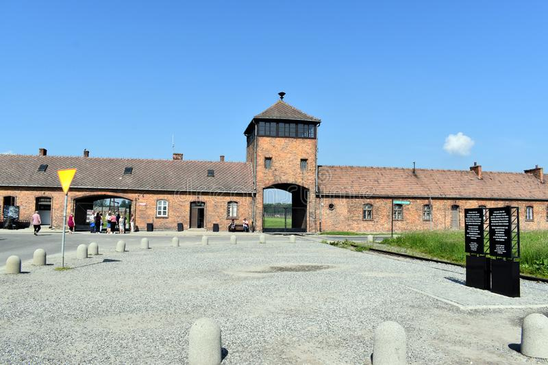 The main entrance to Birkenau Concentration Camp. Birkenau/Poland-June 3, 2019: The main entrance to Birkenau Concentration Camp in Birkenau Poland royalty free stock images
