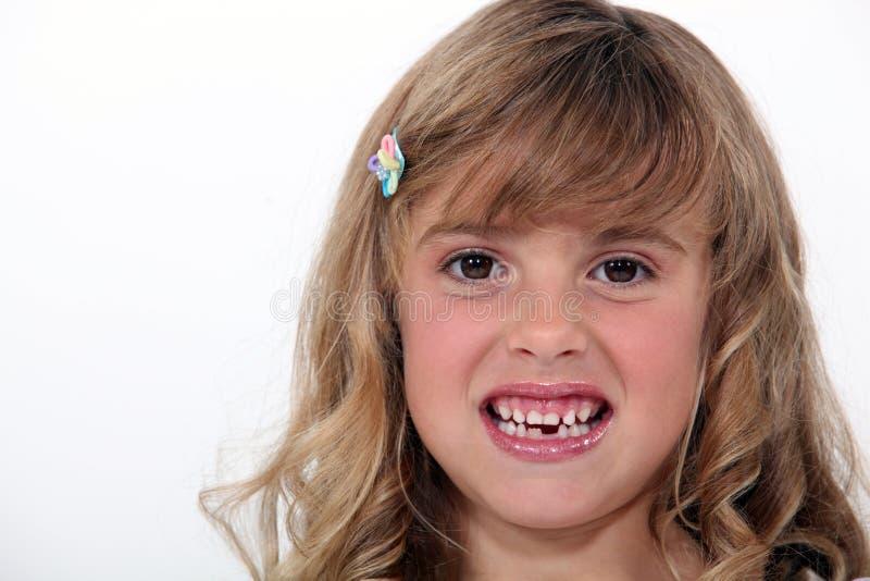 Birl baring her teeth. Little girl baring her teeth stock image