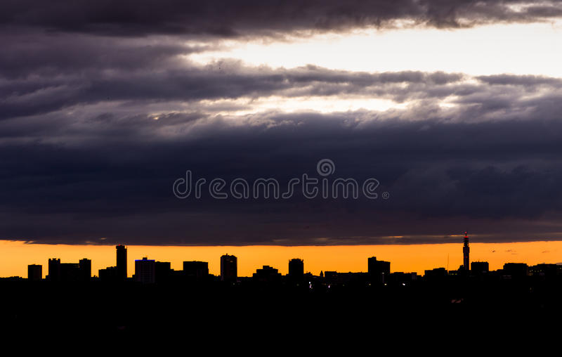 Birmingham city skyline silhouette at sunset. Birmingham City (England) skyline as seen from Oakland Recreational Park at sunset royalty free stock photo
