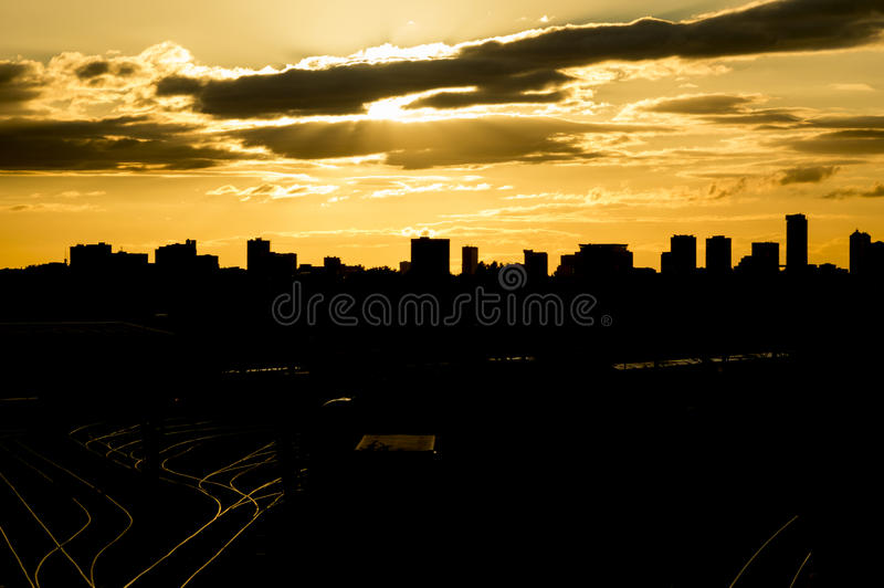 Birmingham city skyline silhouette at sunset. Birmingham City (England) skyline as seen from Tyseley (train station) as a silhouette at sunset stock photo