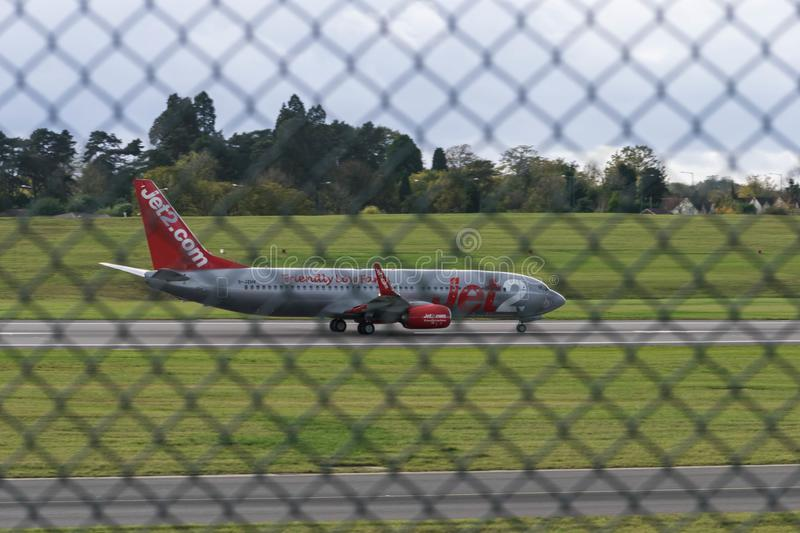 BIRMINGHAM INTERNATIONAL AIRPORT, BIRMINGHAM, UNITED KINGDOM - OCTOBER 28, 2017: plane landing in airfield surrounded by royalty free stock photography
