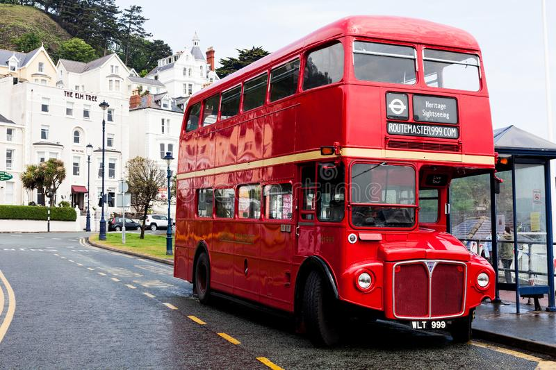 BIRMINGHAM, UK - March 2018 Red Double Decker Bus for Sightseeing and Mass Touring is Stationed beside Empty Waiting royalty free stock photos