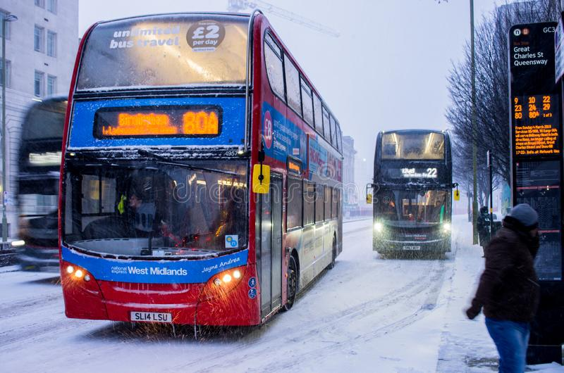 Heavy snow in Birmingham, United Kingdom. Birmingham, United Kingdom - March 02 2018 : Public transport bus during heavy snow in Birmingham, United Kingdom royalty free stock images