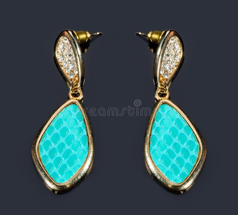 Birnen-Diamant-grüne Ohrringe stockfotos