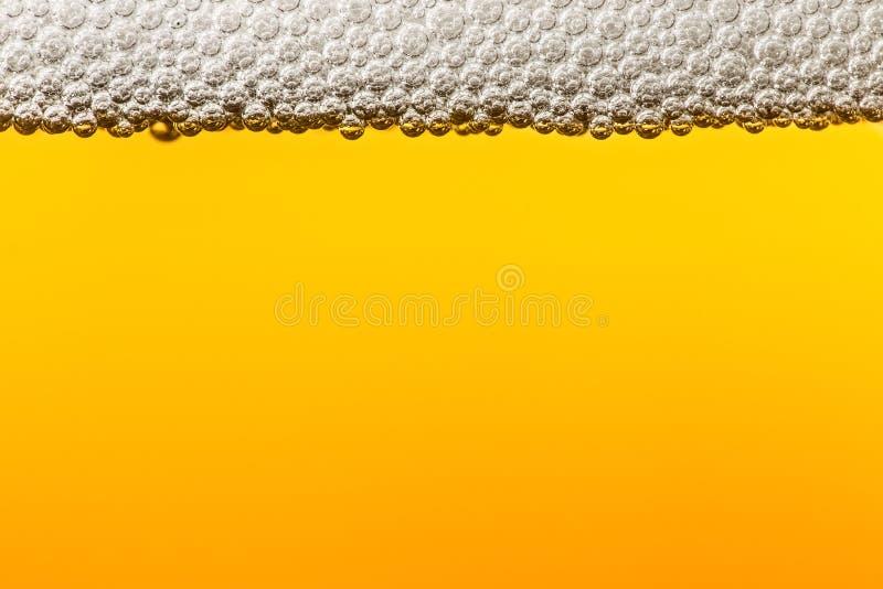 Birra con schiuma Macro fotografie stock libere da diritti