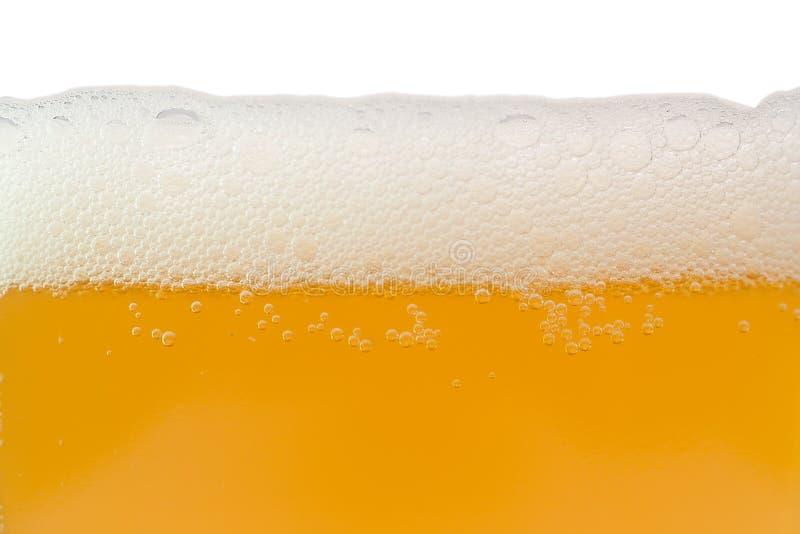 Birra non filtrata con gomma piuma immagini stock libere da diritti
