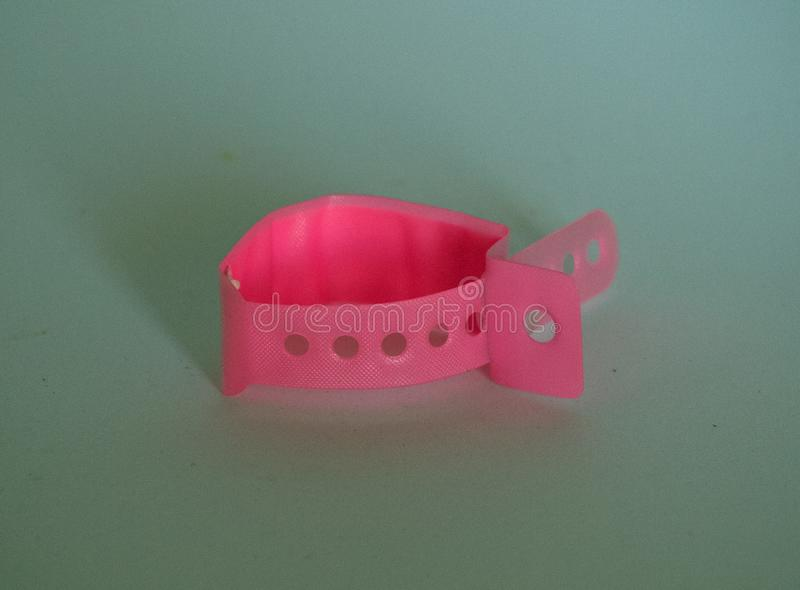 Birth bracelet pink for a baby girl stock photography