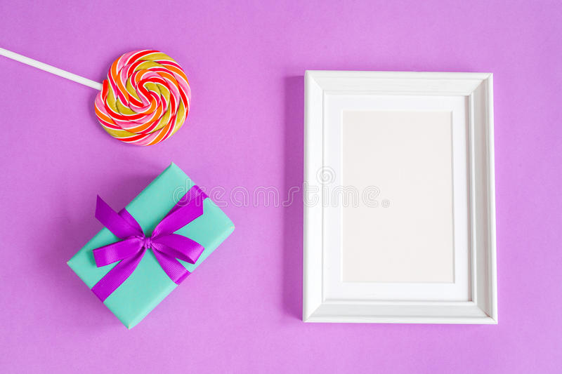 Birth of child - blank picture frame on purple background royalty free stock images