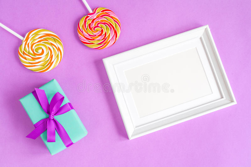 Birth of child - blank picture frame on purple background royalty free stock image