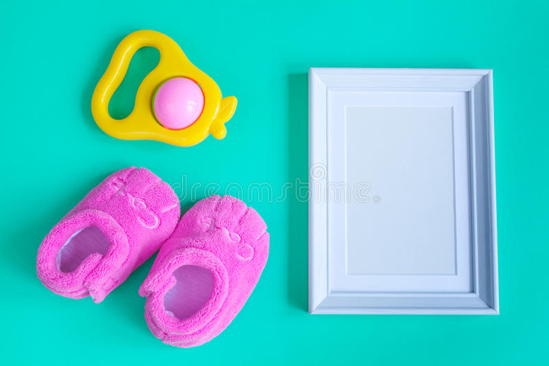 Birth of child - blank picture frame on turquoise background royalty free stock photography