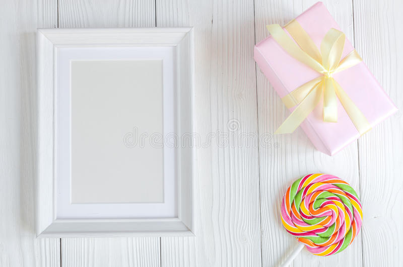 Birth of child - blank picture frame on wooden background royalty free stock images