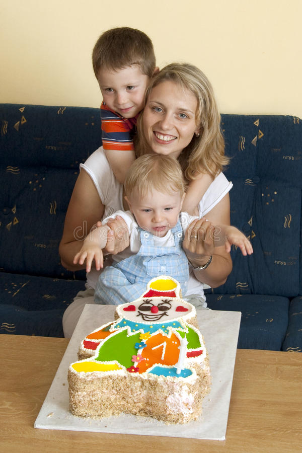 Birthday. Family portrait of mother and two boys celebrating child's first birthday stock images